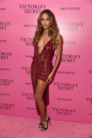 Jasmine Tookes teamed her dress with a pair of strappy black sandals.