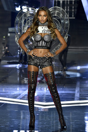 Thigh-high cage boots by Brian Atwood finished off Jasmine Tookes' fierce ensemble.