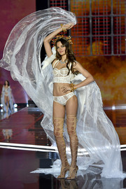 Barbara Fialho accentuated her legs with a pair of nude thigh-high gladiator heels by Brian Atwood.