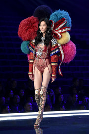 Liu Wen wrapped up her gorgeous legs in embellished gladiator heels by Brian Atwood.