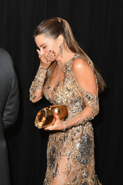 Sofia Vergara sparkled spectacularly with this metallic clutch and beaded gown combo at the Weinstein Company Golden Globes after-party.