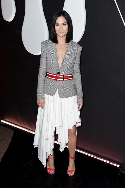 Leigh Lezark added pops of red with a pair of strappy heels and a striped belt.