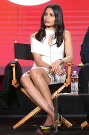 Freida Pinto made a fashion-forward choice with this white one-sleeve cutout dress for the 2017 Winter TCA Tour.