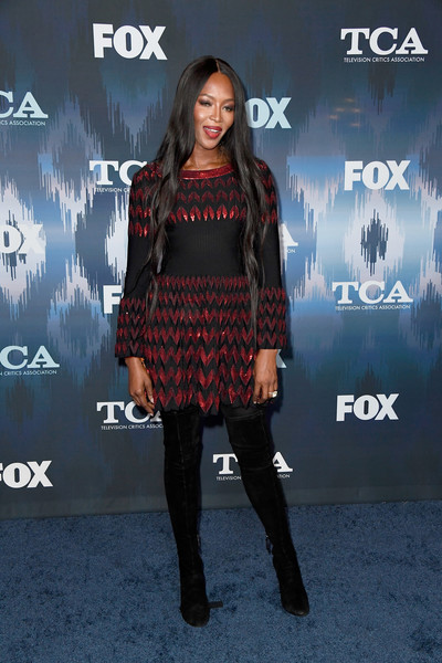 Naomi Campbell polished off her look with black suede thigh-high boots.