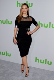 KaDee Strickland complemented her LBD with black slim-strap heels.