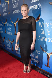 Chelsea Handler made a stylish arrival at the Writers Guild Awards in a little black dress with a sheer yoke, sleeves, and hem.