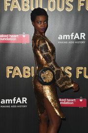 Maria Borges paired a studded circle crossbody bag with a heavily beaded dress, both by Balmain, for the 2017 amfAR Fabulous Fund Fair.