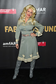 Ellie Goulding came dressed as Dolly Parton in a fringed slate-blue shirtdress to the 2017 amfAR Fabulous Fund Fair.
