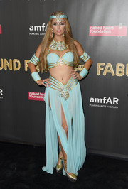 Paris Hilton showed off her trim figure when she came dressed as Princess Jasmine in a turquoise bra at the 2017 amfAR Fabulous Fund Fair.