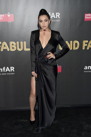 Charli XCX flashed her cleavage and leg in a plunging, high-slit wrap gown by Redemption at the 2017 amfAR Fabulous Fund Fair.
