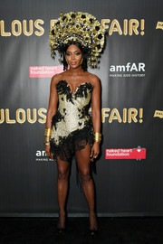 Naomi Campbell unleashed her inner showgirl in a strapless gold and black mini dress by The Blonds at the 2017 amfAR Fabulous Fund Fair.