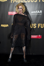Anja Rubik looked seductive in a sheer black dress (but freaked us out with her makeup) at the 2017 amfAR Fabulous Fund Fair.