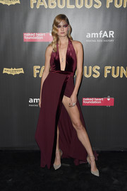 Constance Jablonski was sultry and sophisticated in a plunging burgundy halter gown at the 2017 amfAR Fabulous Fund Fair.