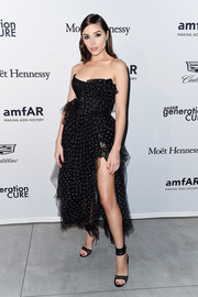 Olivia Culpo continued the girly vibe with a pair of black lace sandals.