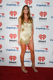 Heidi Klum complemented her dress with a pair of metallic star sandals by Chiara Ferragni.
