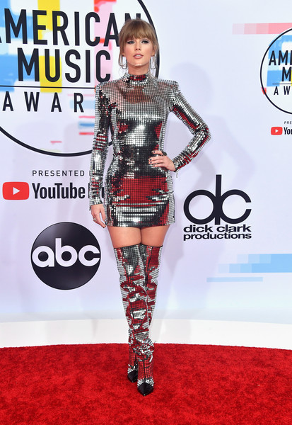 Taylor Swift went for futuristic glamour in a silver plate-embellished mini dress by Balmain at the 2018 American Music Awards.