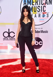 Camila Cabello pulled her look together with a pair of black platform peep-toes by Christian Louboutin.