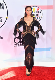 Heidi Klum was hippie-glam in a fringed black crochet gown by Julien Macdonald at the 2018 American Music Awards.