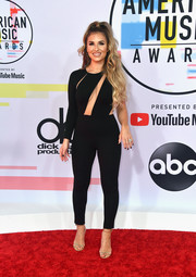 Jessie James Decker styled her look with barely-there gold heels.