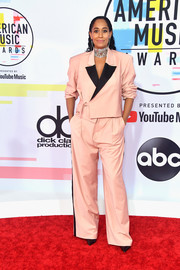 Tracee Ellis Ross went menswear-chic in a blush pantsuit by Pyer Moss at the 2018 American Music Awards.