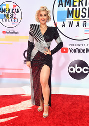 Bebe Rexha cut a bold silhouette in a pointy-shouldered sequined and beaded gown by Balmain at the 2018 American Music Awards.