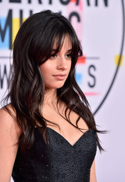 Camila Cabello wore her hair down in a wavy style with eye-grazing bangs at the 2018 American Music Awards.