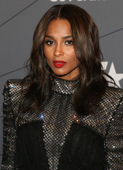 Ciara brightened up her beauty look with a swipe of matte red lipstick.