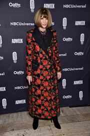 Anna Wintour was winter-glam in a floral brocade coat at the 2018 Brand Genius Awards.