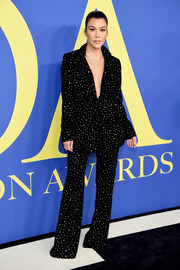 Kourtney Kardashian looked groovy in an embellished black pantsuit by Christian Siriano at the 2018 CFDA Fashion Awards.