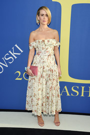 Sarah Paulson paired her lovely dress with pink velvet sandals by Chloe Gosselin.