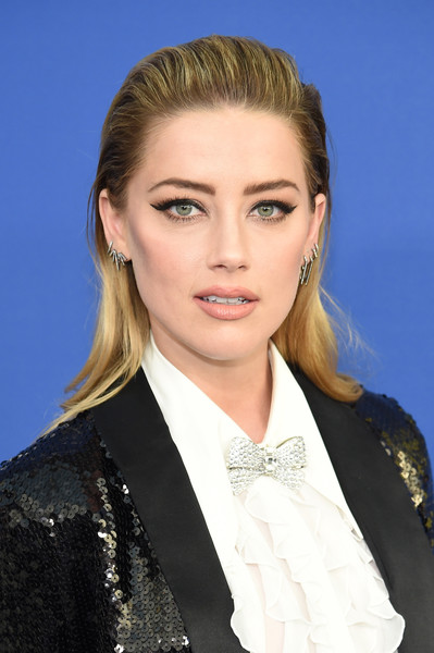 Amber Heard sported an edgy brushed-back hairstyle at the 2018 CFDA Fashion Awards.