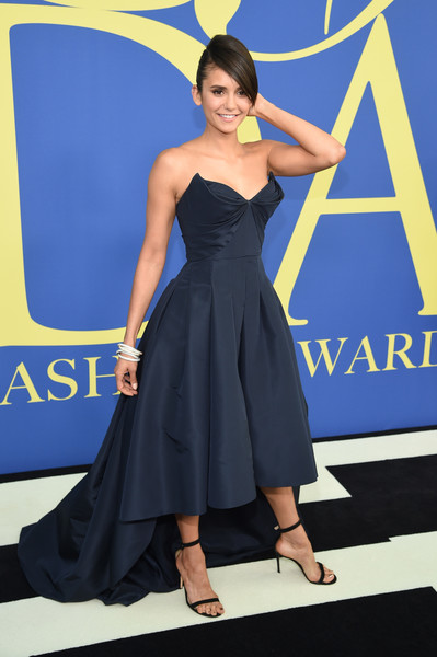 Nina Dobrev went for a princess-y strapless ball gown by Zac Posen when she attended the 2018 CFDA Fashion Awards.