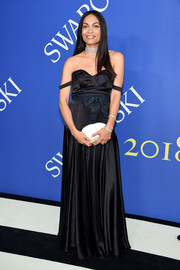 Rosario Dawson donned an off-the-shoulder satin gown by Studio One Eighty Nine for the 2018 CFDA Fashion Awards.