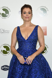 Bellamy Young matched a royal-blue satin clutch with an embroidered dress for the 2018 Farm Sanctuary on the Hudson Gala.