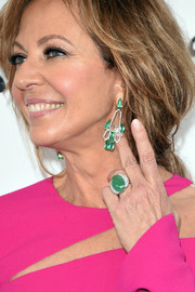 Allison Janney's green cocktail ring and earrings made a striking contrast to her hot-pink outfit!