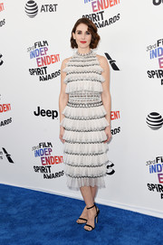 Alison Brie finished off her outfit with black ankle-strap sandals by Jimmy Choo.