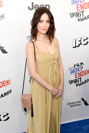 Abigail Spencer attended the 2018 Film Independent Spirit Awards carrying a blush shoulder bag with black tassels.