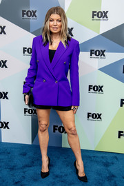 Fergie teamed a purple Versace blazer with black shorts for the 2018 Fox Network Upfront.