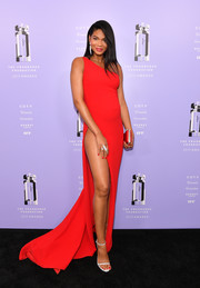 Chanel Iman rocked a red Romona Keveza one-shoulder dress with a hip-high slit at the 2018 Fragrance Foundation Awards.