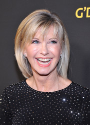 Olivia Newton-John attended the 2018 G'Day USA Black Tie Gala wearing her hair in a bob with wispy bangs.