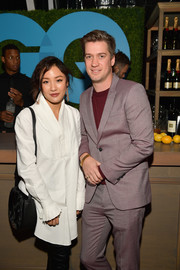 Constance Wu paired a black satchel with a white tunic dress for the 2018 GQ Men of the Year party.