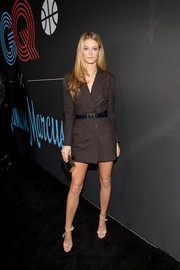 Kate Bock styled her dress with a pair of nude ankle-tie sandals.