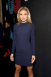 AnnaLynne McCord displayed her slim physique in a form-fitting navy sweater dress at the 2018 GQ All-Star Party.