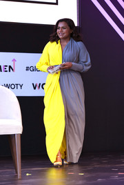 Mindy Kaling brought a bright pop of color onstage at the 2018 Glamour Women of the Year Summit with this neon-yellow and gray gown by Greta Constantine.