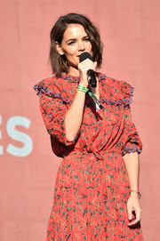 Katie Holmes paired a simple gold bangle with a red print dress for the 2018 Global Citizen Festival.