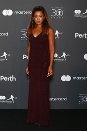 Naomi Osaka glammed up in a purple sequined gown for the 2018 Hopman Cup New Year's Eve Ball.