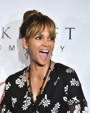 Halle Berry styled her hair into a top knot with eye-skimming bangs for the 2018 Imagine cocktail party.