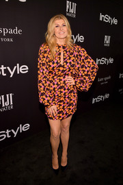 Connie Britton showed off her legs in a floral mini dress at the 2018 InStyle Awards.