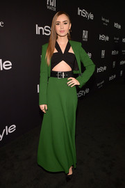 Lily Collins' Givenchy ensemble at the 2018 InStyle Awards, consisting of a green cropped jacket, a matching maxi skirt, and a black crop-top, was a bold way to suit up!