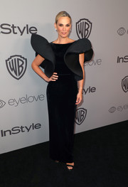 Molly Sims made a dramatic entrance in a black Alberta Ferretti Couture gown with wing-like sleeves at the Warner Bros. and InStyle Golden Globes after-party.